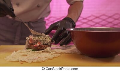 Chef Lay On A Vegetable Filling For A Vegan Burger - The...