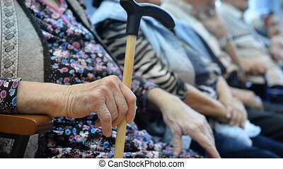 The hands of the elderly in a nursing home for the elderly...