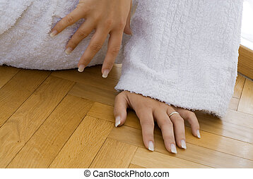 the hands - young and cute blond woman wearing a white...