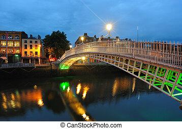 The Ha'penny Bridge over the River Liffey in Dublin, Ireland.