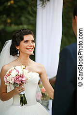 The happinest bride with bouquet