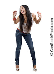 The happy beautiful young woman in jeans. Isolated
