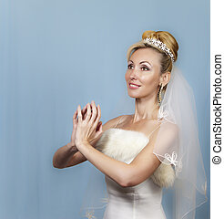 The happy bride on a blue backgroun