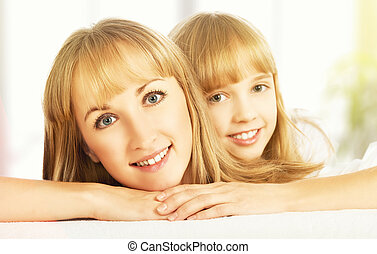 happy faces of the mother and daughter