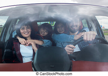 Happy family in the car, travel