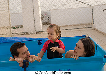 The happy family play in pool