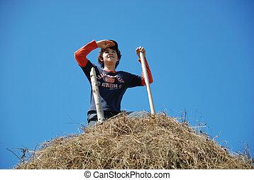 The happy guy on a haystack