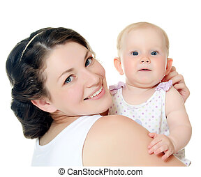 The happy mother with baby