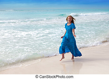 The happy woman on sea coast
