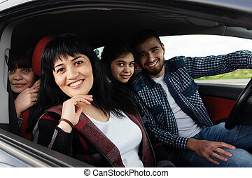 Happy woman with family in the car