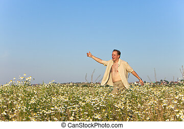 young man  in the field of camomile