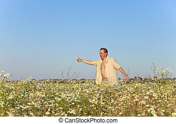 happy young man  in the field of ca
