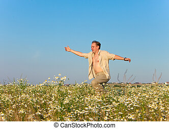The happy young man in the field of