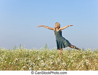 woman in the field  of camomiles
