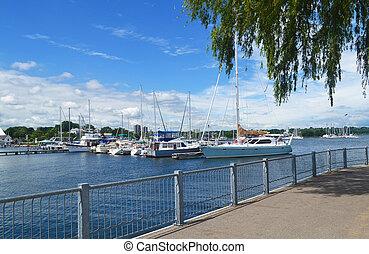 The harbor of Hamilton with sealcoats under blue sky