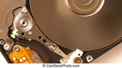 Data storage technology. Hard drive. The head reads data from a magnetic disk. Macro