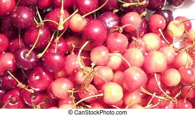 The harvest of juicy cherry on the plate rotates