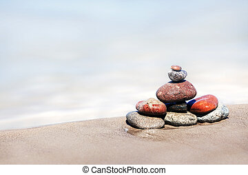 The heap of stones on a sandy beach
