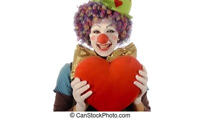 Sweet clown showing a big red heart over white bakground. Clown loves you.