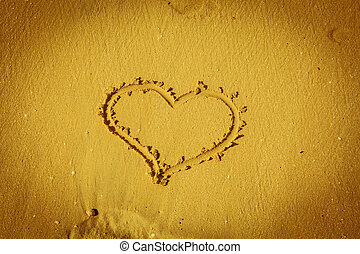 the heart on beach sand