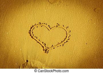 the heart on beach sand