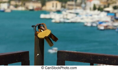 The hearts of two - Padlocks against the backdrop of a blue...