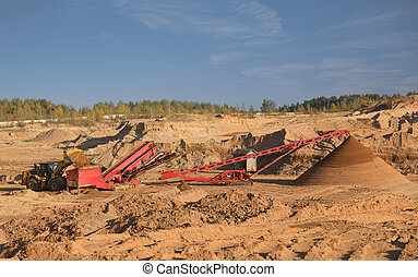 The heavy tractor works in a sand quarry