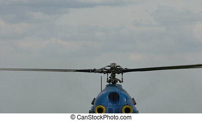 The helicopter is preparing to take off close up. - The...