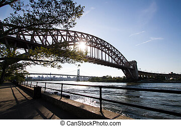 The Hell Gate Bridge and Triborough bridge with the sun, Astoria park, New York