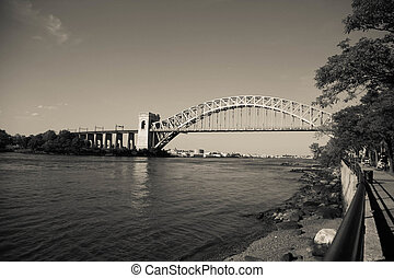 The Hell Gate Bridge and walkway in vintage style at Astoria park, New York