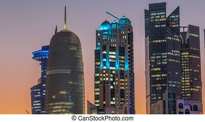 The high-rise district of Doha day to night timelapse after...