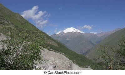 The highest point of Europe, Mount Elbrus. View from the eastern gorge. Camera movement