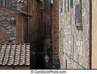 the historic center of Colle Valdelsa, glimpse of a medieval...