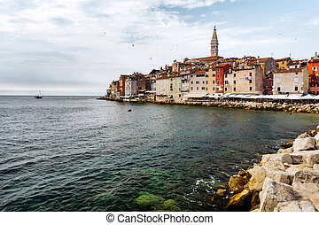 The historic part of Rovinj in Croatia with the Church of Saint Euphemia and the sea