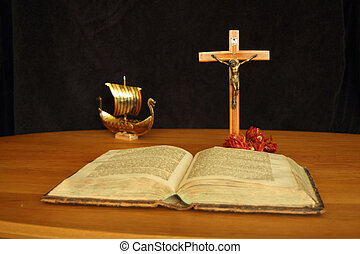The holy book and christen vikings - A longboat with...