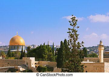 The Holy City of Jerusalem is lit by the sun
