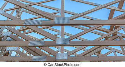 The horizontal beams of a wooden building pano