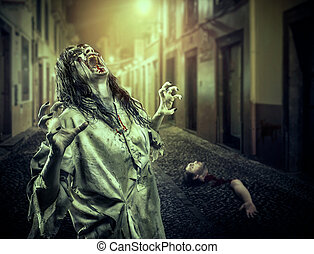 The horror shouting zombie girl on the dark street