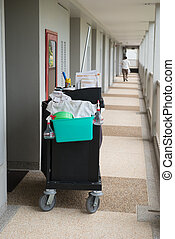The hotel cleaning tool cart of housekeeper are on the walkway