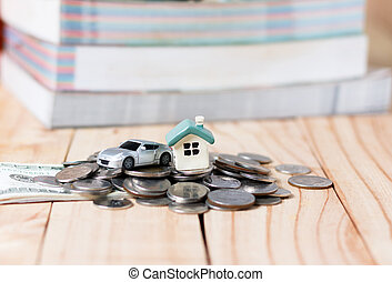 The house and a car on the pile of money in the concept of...
