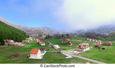The house and the village in the mountains. The village...