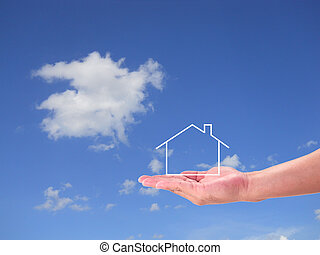 The House in the hands against the blue sky