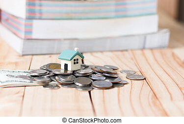 The house on the pile of money in the concept of money to...