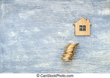The house symbol is made of bamboo and yellow shiny coins on a scratched gray background with a blue tint.