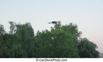 The hovering of drone slow motion professional quadcopter UAV camera movement