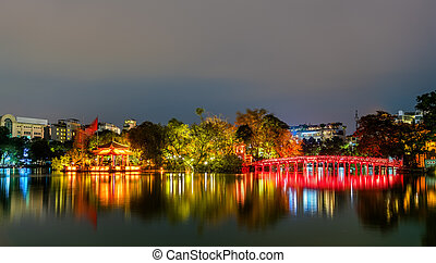 The Huc Bridge leading to the Temple of the Jade Mountain on Hoan Kiem Lake in Hanoi, Vietnam