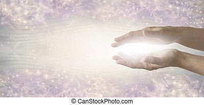 The humble hands of a light worker sending healing energy