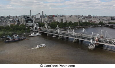 The Hungerford Bridge crosses the River Thames in London