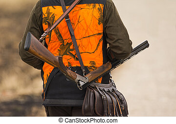 The hunter in the hunting clothes with a new hunting rifle