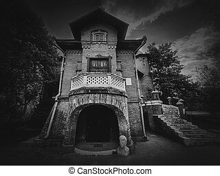 The Hunting Castle at Manuc Bei mansion, an architectural, culture and historic complex, Hincesti city, Moldova. Old brick building, black and white photo. Halloween haunted house concept, ghost home.